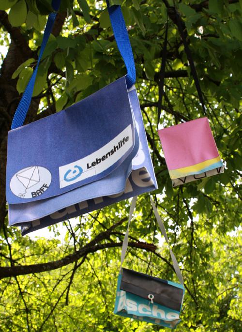 Werbebanner zu Taschen. Foto: Gerhard Schindler